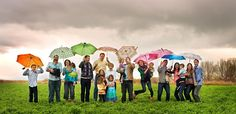 Fun large family photo! Would love neutral clothes with many colorful umbrellas too!
