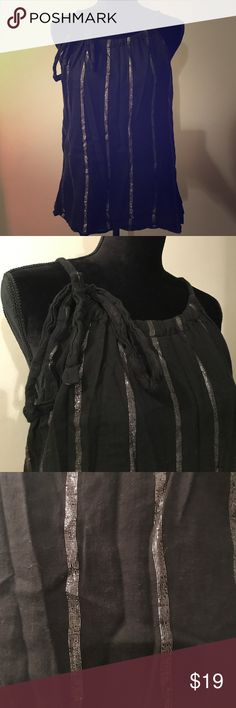 🖤Old Navy Tank Top Large Black Silver Stripes One Old Navy tank top, women's size large. It is black with silver sparkly stripes. The straps are adjustable and tie in the front. (See photos) This Top's shell was made in China out of 99% cotton and 1% other fiber while the lining was made out of 100% cotton. Although this top is preowned it is still in excellent condition showing no signs of wear such as tears or stains. Dress it up or dress it down, this top will work either way ☺️ Old Navy…