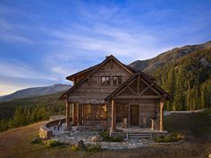 This breathtaking rustic mountain retreat was designed by Miller Architects along with custom builder Yellowstone Traditions, located in Big Sky, Montana.