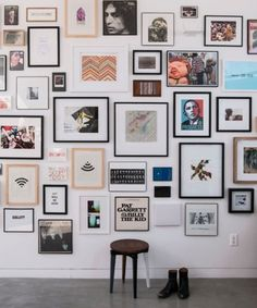 Gallery Wall.  Do This With Black and White Photographs and Different Frames.