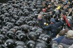 Protesters clash with police at Presidential office in Kyiv, on Sunday.