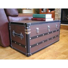 This beautiful wood trunk features old fashioned hardware for an antique look. This decorative treasure chest is great as a coffee table or end table, and can also be used a convenient storage solution.