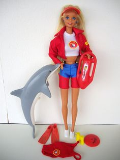 Heehee! Sam and I both had this doll. We begged our parents to buy each of us one when we went to SeaWorld in the '90s and saw the Baywatch show. Barbie Baywatch | Flickr - Photo Sharing!