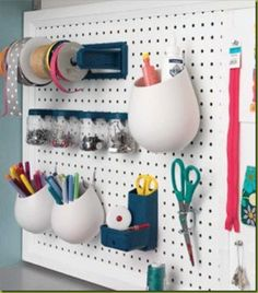 pencil cups in pegboard