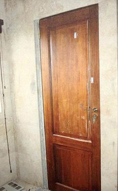 The bathroom door with the bullet holes.  Prosecutors claim Pistorius murdered Steenkamp.  He claims he though an intruder was in the bathroom.