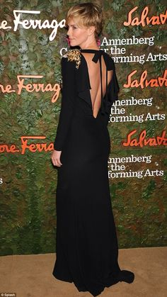 Charlize Theron cuts a willowy figure in a black gown with gold embellished shoulders at star-studded bash Evening Outfits, Formal Evening Dresses, Gown Drawing, Dress Outfits, Fashion Dresses, Wine Red Dress, Classy Winter Outfits, Charlize Theron, Minimal Fashion