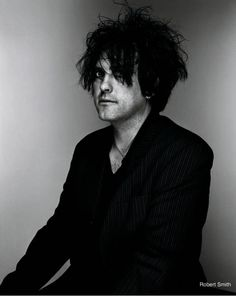 So much better looking without the makeup. I am fascinated by Robert Smith <3
