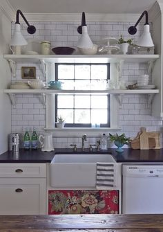 shelves in front of window, white subway tile with dark grout