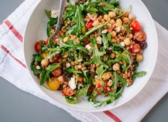The season's first cherry tomatoes, spicy arugula, chickpeas, olives and feta combine with warm, tender farro for a satisfying meal.