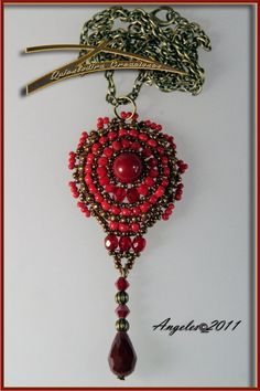 Beautiful pendant; love the red/antique brass combo. Schema here, fairly simple.
