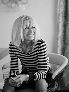 """BETSEY JOHNSON, American designer (b. 1942). She is best known for her feminine and whimsical designs. Many of her designs are considered """"over the top"""" and embellished. She also is known for doing a cartwheel at the end of her fashion shows."""