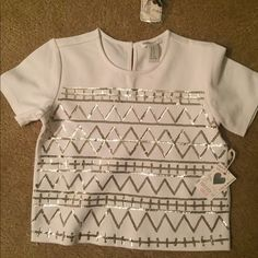SATURDAY SALE  Cream color. Gold design. Cropped bottom but not a crop top. Thick material. Forever 21 Tops Tees - Short Sleeve