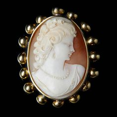 Cameo profile brooch. Yellow gold (750/1000), 19 g.
