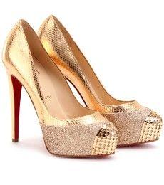 Gold snakeskin platform pumps! i want them bad!