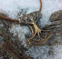 Thor's hammer decorated with the World tree Yggdrasil.
