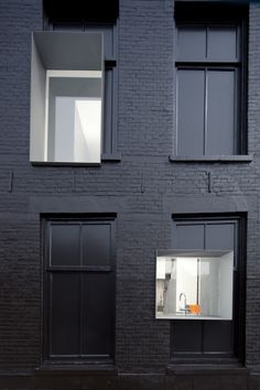New window punctuating the existing 100 year old facade of the Black Pearl, by Studio Rolf.fr in collaboration with Zecc Architecten, Rotterdam. The existing windows have been painted black. Black Architecture, Architecture Details, Interior Architecture, Beautiful Architecture, Rotterdam, Black Exterior, Interior Exterior, Modern Exterior, Store Concept