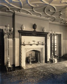 glenallen2097.jpg  Title	Fireplace with urns at Glenallen (1915-1945)  Subject	Glenallen (Cleveland Heights, Ohio)  Fireplaces  Ceilings  Urns  Description	A fireplace with woodcarving at Glenallen (also known as Glen Allen) is pictured. Glenallen, the home of Elisabeth Severance Allen Prentiss, was designed in the English manorial style by Charles Schweinfurth in 1914. It was located at 3505 Mayfield Road, Cleveland Heights until it was demolished in 1945.