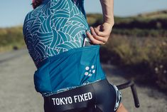 The Tokyo Fixed Wing Jersey in bright turquoise with pink wing details really stands out.