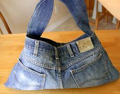 How to Make a Denim Purse ....Jeans have a lot of character and style, even if they're worn out or outgrown. You can transform that style into a unique purse. All you need is an old pair that you can cut up. Then embellish them!!!