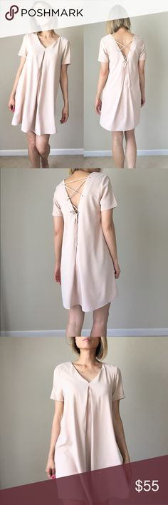 """Midi dress lace up v back in Taupe Full lining .Chic clean cut, well made with lace up back Midi dress in black. Comes with lining. My favorite piece for basic chic. Cris cross open back. Size S: length : 33"""", chest: 34"""", W: 38"""", size M: length 34"""", chest: 35"""" , W; 39"""", size L; length 34, chest; 36, w; 40.  96% polyester 4%spandex. TAUPE COLOR KC Dresses Midi"""