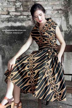 8f4e72ee2fd47 Batik Amarillis Made In Indonesia Batik Amarillis s Hey Day Wrap dress Our  new classy   classic dress inspired . Full skirt with large box  pleats