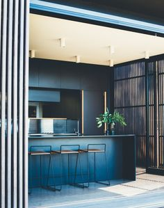 This Australian Abode Is a Glass Pavilion Wrapped in Sliding Hardwood Screens - Photo 3 of 11 - The building is kept low to the ground, so you can step directly from the house into the garden.