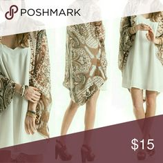 BOHO Shrug FITS EVERYONE Super lightweight and Chic can dressed up or down with jeans, shorts or go to a wedding with chains or pearls. I love versatility in my wardrobe and so will you. Nwot Also comes in orange and turquoise tones in a separate listing. Boutique By The Bay Tops