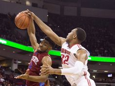 Ohio State Buckeyes center Trevor Thompson (32) and South Carolina State Bulldogs guard Gabe McCray (0) fight for a rebound at Value City Arena.