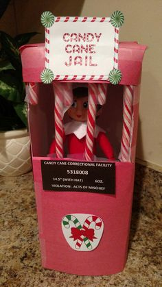 Elf on the Shelf Candy Cane Jail -- use a Kleenex box (with opening in back to get elf in and out)