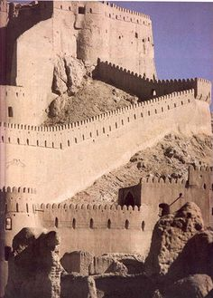 """The Arg-é Bam (ارگ بم in Persian, """"Bam citadel"""") was the  largest adobe building in the world, located in Bam, a city in the  Kerman province of southeastern Iran"""