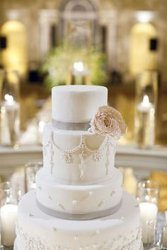 cake: buttercream (not fondant), carrot cake, ivory, blush, or silver ribbon, an ivory garden rose or peony