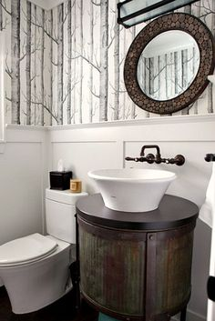 chic powder room with walls papered in antonina vella dolce vita