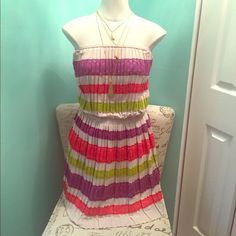 NWT Bcbg strapless dress New with tags! Fantastic summer dress! Light and flowy with colorful panels of lace. Size xs, but could easily fit a small or even medium because of the flowyness. So cute! BCBGMaxAzria Dresses