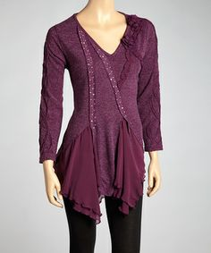 Standout style is in the bag thanks to the design of this linen-blend tunic. Sporting sheer chiffon ruffles, glitzy embellishments and sweet rosettes along the neck, it's the kind of piece that gets a gal noticed.