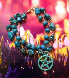 Double stranded turquoise stone bracelet with pastel green pentacle charm.Turquoise stones aid spiritual attunement, communication, boost psychic gifts of clairaudience & clairvoyance & aid past life healing. Fastens with a lobster clasp and is approx 8 inches long.