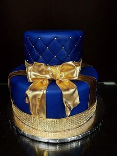 Food: Blue and gold tiered cake