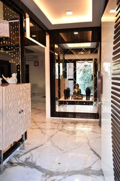 The foyer welcomes with grand bevelled edge grey mirror on the opposite wall and luxury console unit by A.J Architects. Luxury Interior, Interior Design, Modern Foyer, Common Area, Large Windows, Teak Wood, Second Floor, Ground Floor, Architects