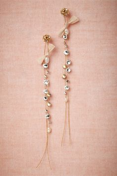 """Willowy Earrings: Dramatic in length, strands of silk studded with Swarovski crystals are topped with a tiny silk bow. Handmade by Cécile Boccara. Silver plated brass posts. 4""""L, 0.25""""W. Silk, Swarovski crystal, silver plated brass, polyester fabric. France.  Exclusive to BHLDN"""