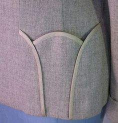 1940s fashion: dress (jacket) detail: Lilli Ann suit pocket formed like a tulip.: