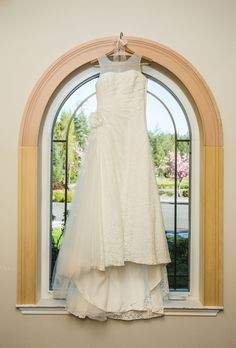 This bride customized her strapless lace wedding gown with a sheer added neckline for modesty and comfort during her religious ceremony. Photo by nallayerstudios.com.