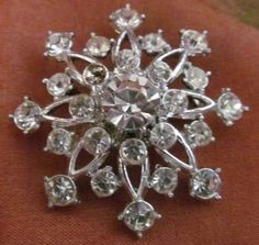 This large snowflake comprised of chunky, gleeming gems will glam up a blazer or tie up a scarf's elegance.