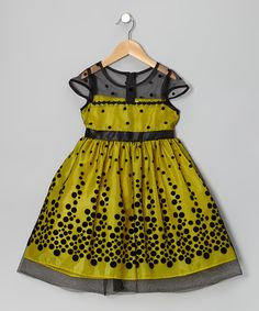 Designed with a unique polka dot pattern and sheer shoulders and overlay, this eye-catching piece goes on easy thanks to the half-zipper in back.100% polyesterDry cleanMade in the USA
