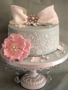 Beautiful pale blue #Stencilled #Cake with gorgeous white bow and pink peony #flower We love and had to share! Great #CakeDecorating