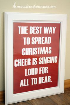 "This festive red and white print is sure to bring a smile to the face of all passerby's this Holiday season. It reads, ""The best way to spread Christmas cheer is singing loud for all to hear."" This would make a great gift for anyone."