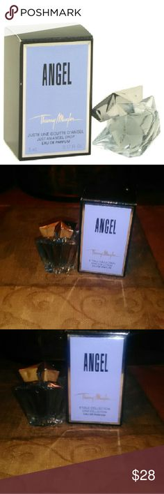 Thierry Mugler Angel Perfume (mini) 100% Authentic Thierry Mugler Angel perfume beautiful scent of red berries,candy floss,creamy caramel,dewberry,bergamot,mandarin,honey, vanilla,chocolate perfect mini size to take with you on the go Thierry Mugler Other