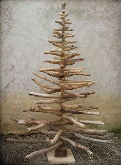 DIY-Driftwood Christmas Tree.  Perfect Tree for a Beach House.  I have seen various sizes of driftwood trees at a local Antique/Flea Market.  Love 'em.