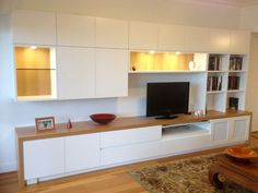 timber and concrete entertainment unit along wall - Google Search