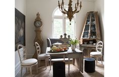 Inside Tara Shaw's Breathtaking New Orleans Home: 18th century Venetian corner cabinet, 19th century Belgian still life, Swedish drop-leaf table, dining room chairs and a grey banquette from Tara Shaw Maison