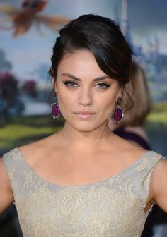 Mila, Michelle, James, and More Premiere Oz the Great and Powerful: Mila Kunis wore a Dolce & Gabbana dress with purple jeweled earrings.