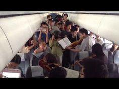 Watch the Philadelphia Orchestra Flashmob an Airplane Stuck on the Tarmac!